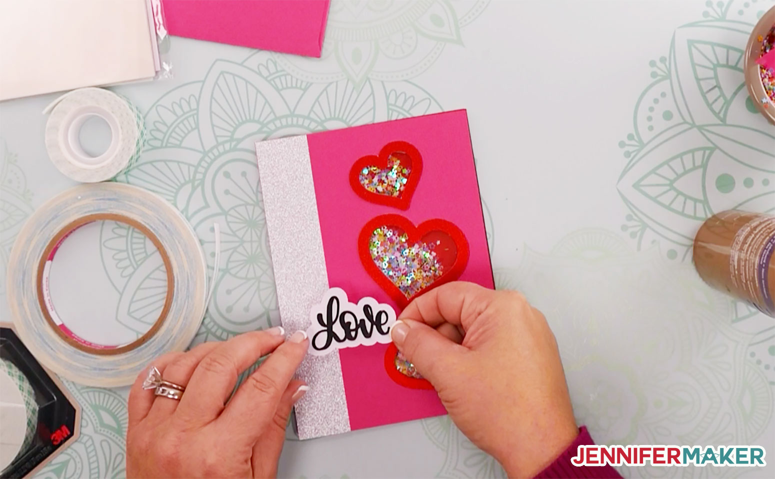 Gluing the love cloud to the front of the shaker card