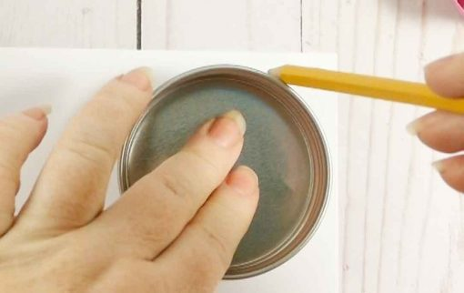 Trace the lid of the Mason jar onto a piece of paper with a pencil