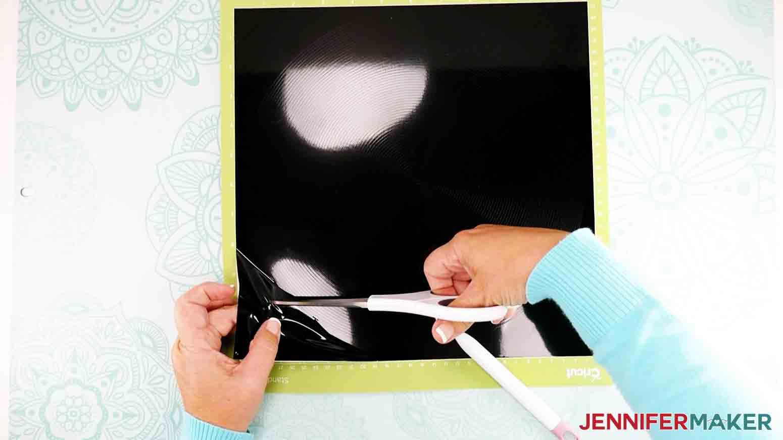 cutting vinyl with scissors