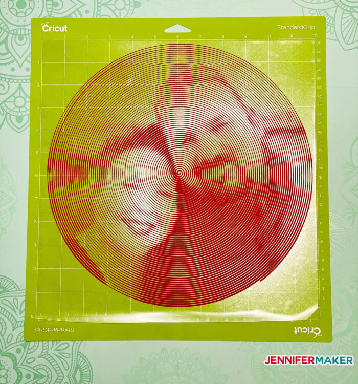 Spiral Betty photo cut from red iron on vinyl on a green standard grip cutting mat