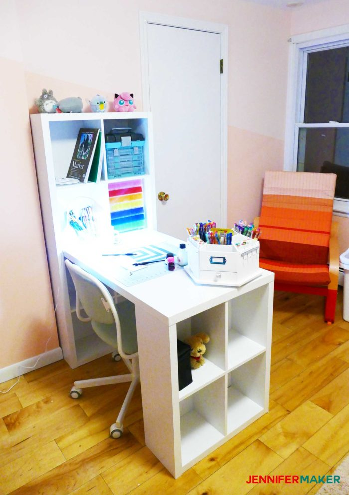 A white craft table in a pink room is an affordable craft table option