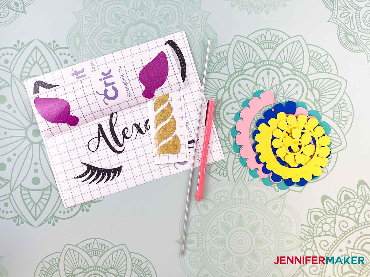 Gather your cut vinyl and paper roses to begin assembling your personalized unicorn frame