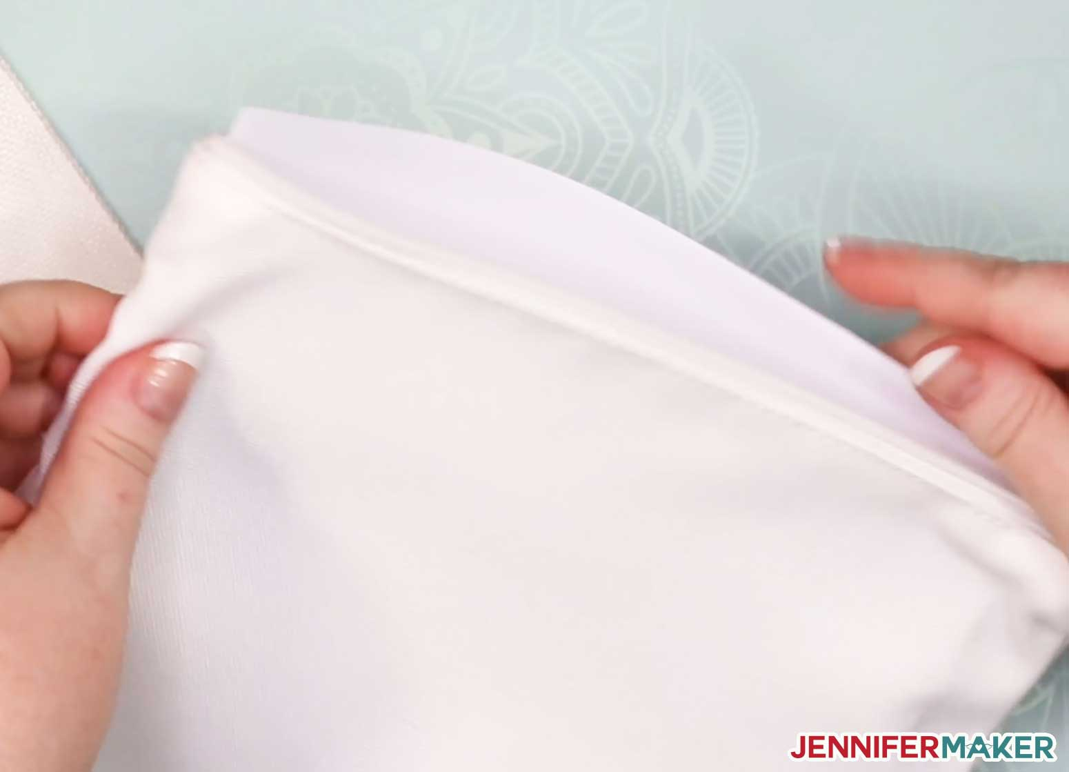 Put a piece of white cardstock inside the zippered pouch to prevent bleedthrough