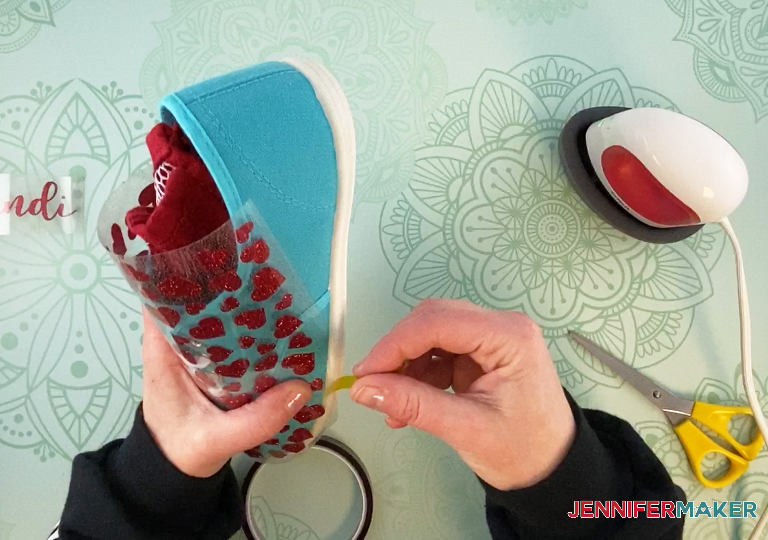 Use heat transfer tape to hold vinyl in place on sneakers