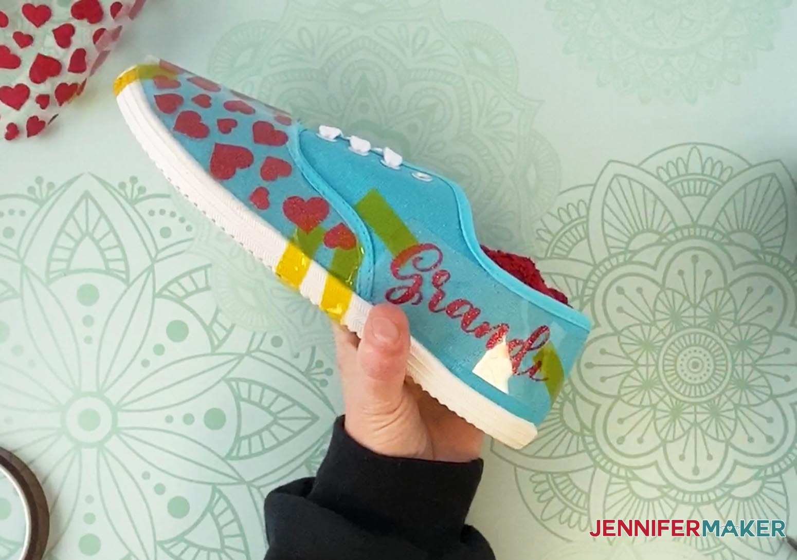 Use heat-transfer tape to hole heat-transfer vinyl in place