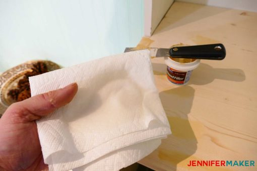 A damp paper towel to use in rubbing and buffing the wood filler for a crazy smooth finish