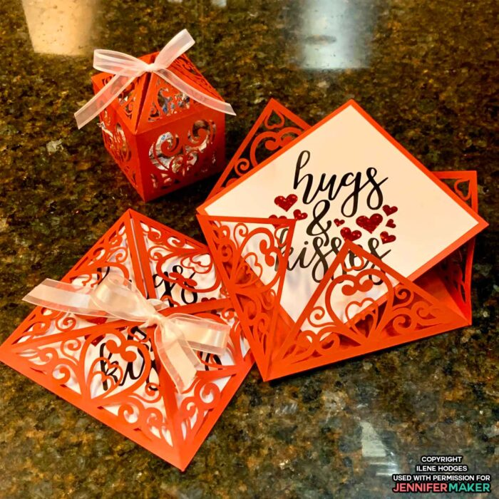 A red filigree card and treat box for Valentine's Day
