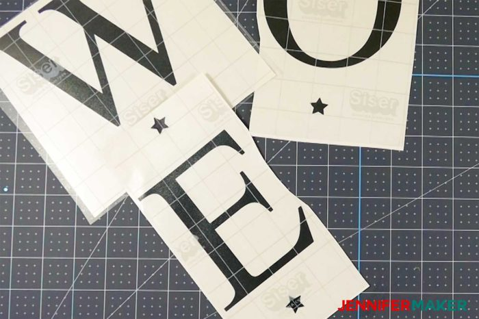 Separated vinyl letters cut out for a vertical welcome sign