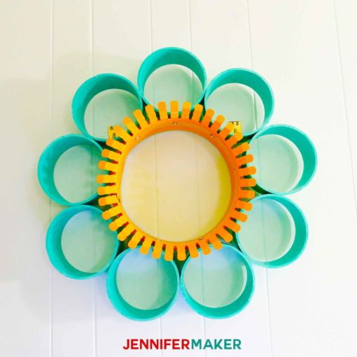 A wallflower made of PVC pipe and a yellow-painted duct collar ring