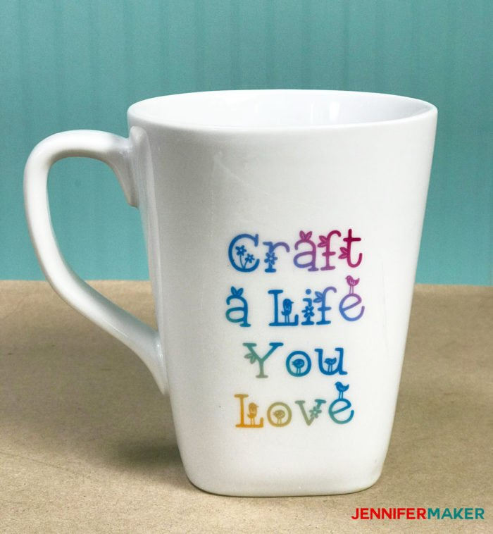 "Waterslide decal mug in white with the words ""Craft a Life You Love"" on it"