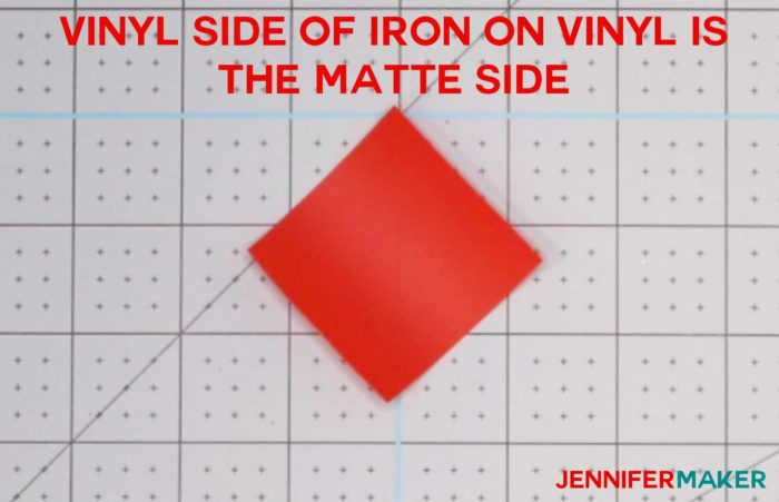 A small piece of red iron-on vinyl matte side up to determine which side of iron on vinyl to cut on!