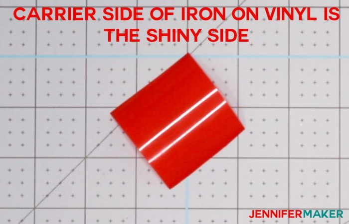 A small piece of red iron-on vinyl shiny side (carrier side) up to determine which side of iron on vinyl to cut on!