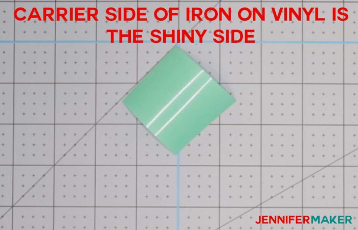 A small piece of aqua iron-on vinyl shiny side (carrier side) up to determine which side of iron on vinyl to cut on!