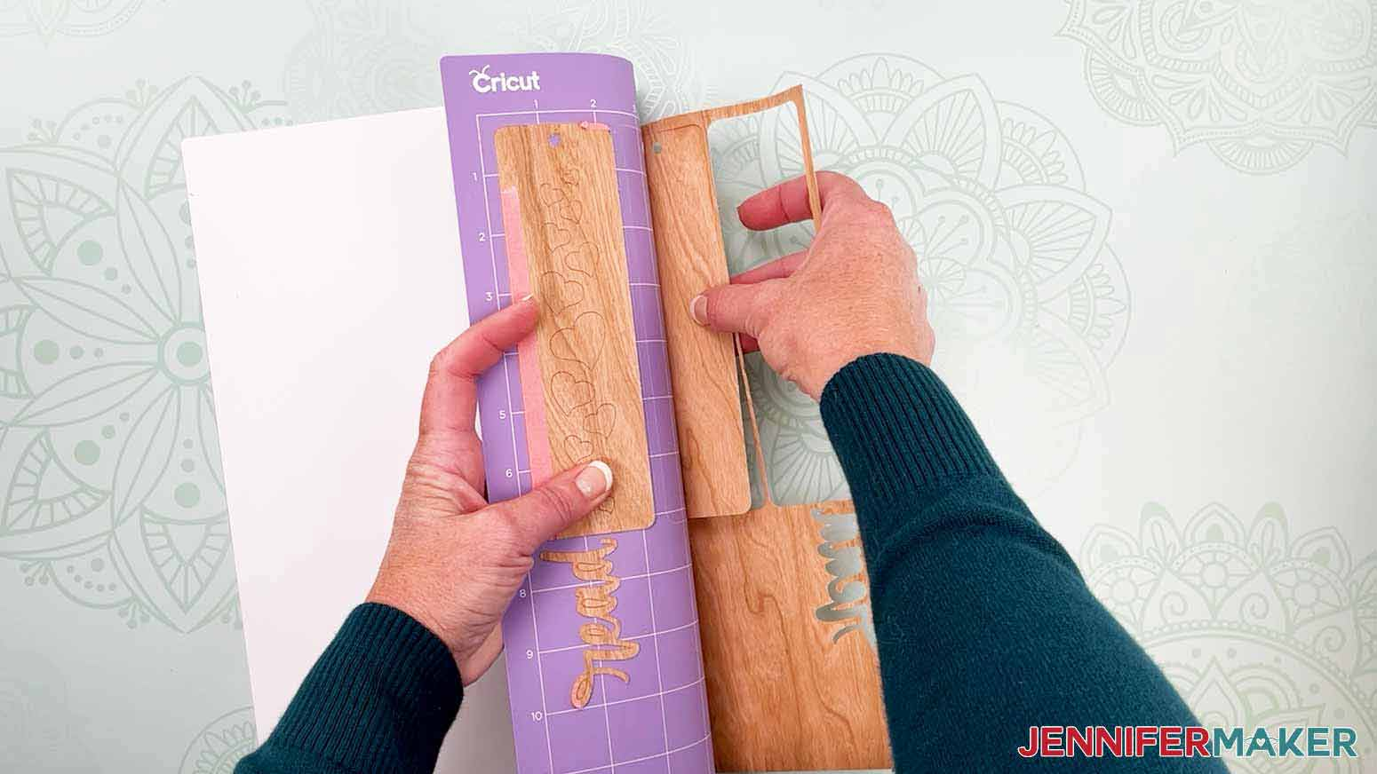 Flip your cutting mat over and peel back away from the veneer to remove it for my wooden bookmarks project
