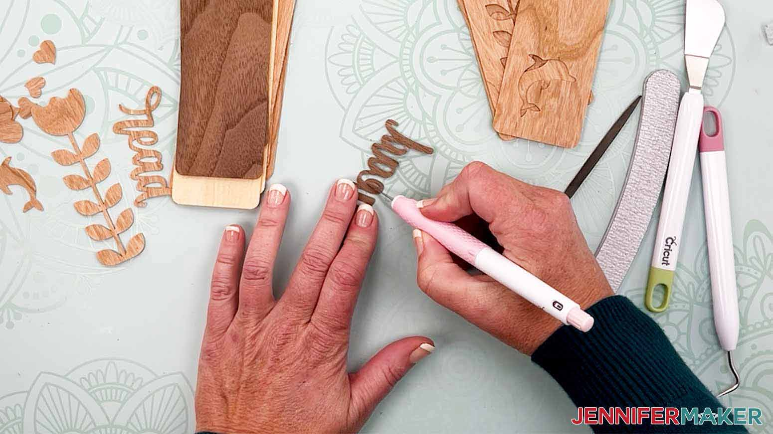 Use a knife blade to remobe stubborn pieces from the veneer for my wooden bookmarks project