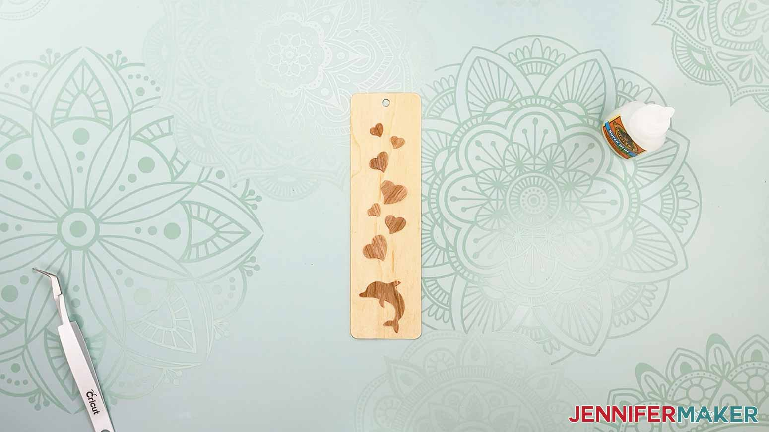 This is what my bookmark looks like using the dolphin and heart pieces from my wooden bookmarks project