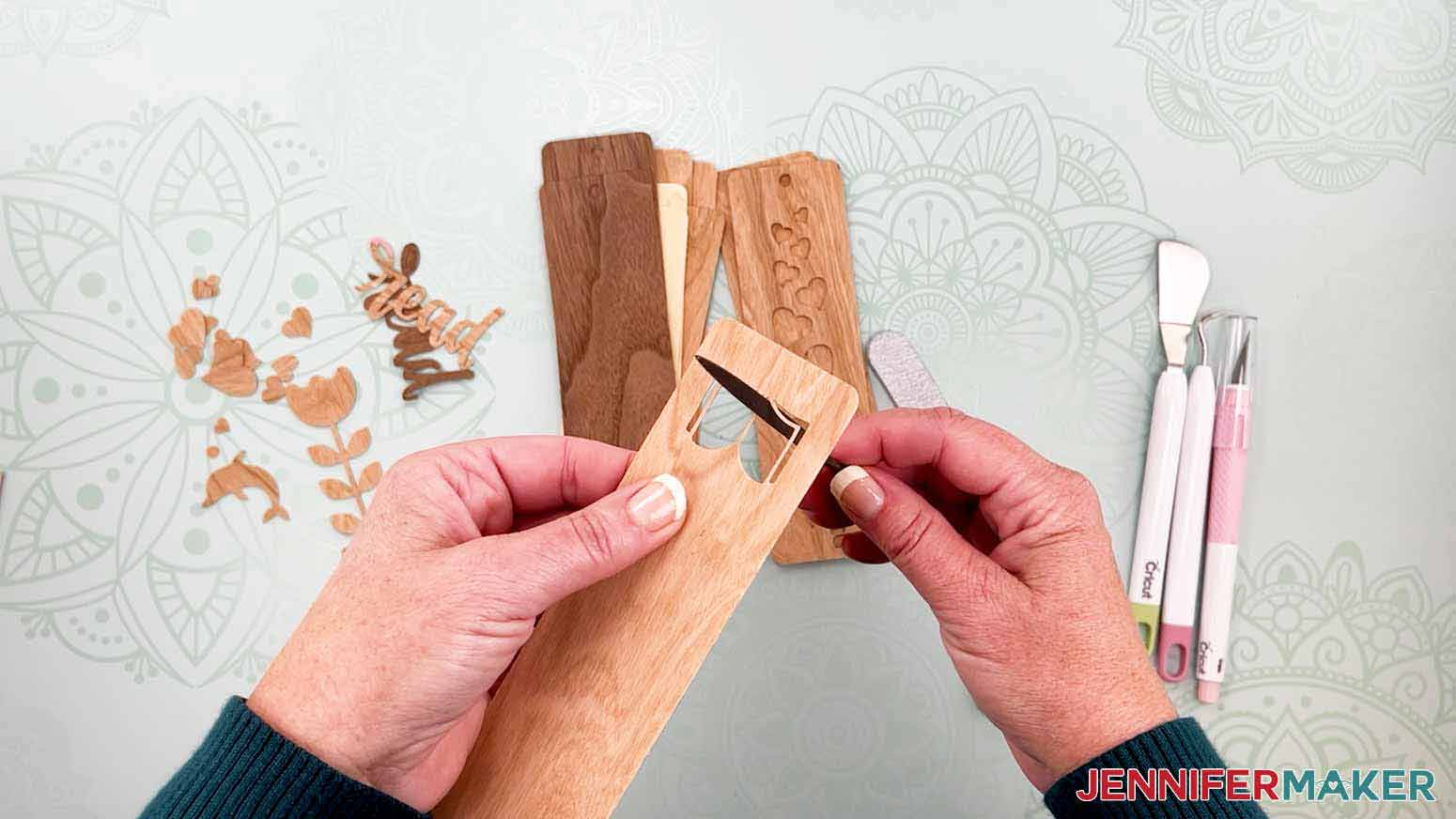 Use a file or sandpaper to smooth the inside of the cuts for my wooden bookmarks project