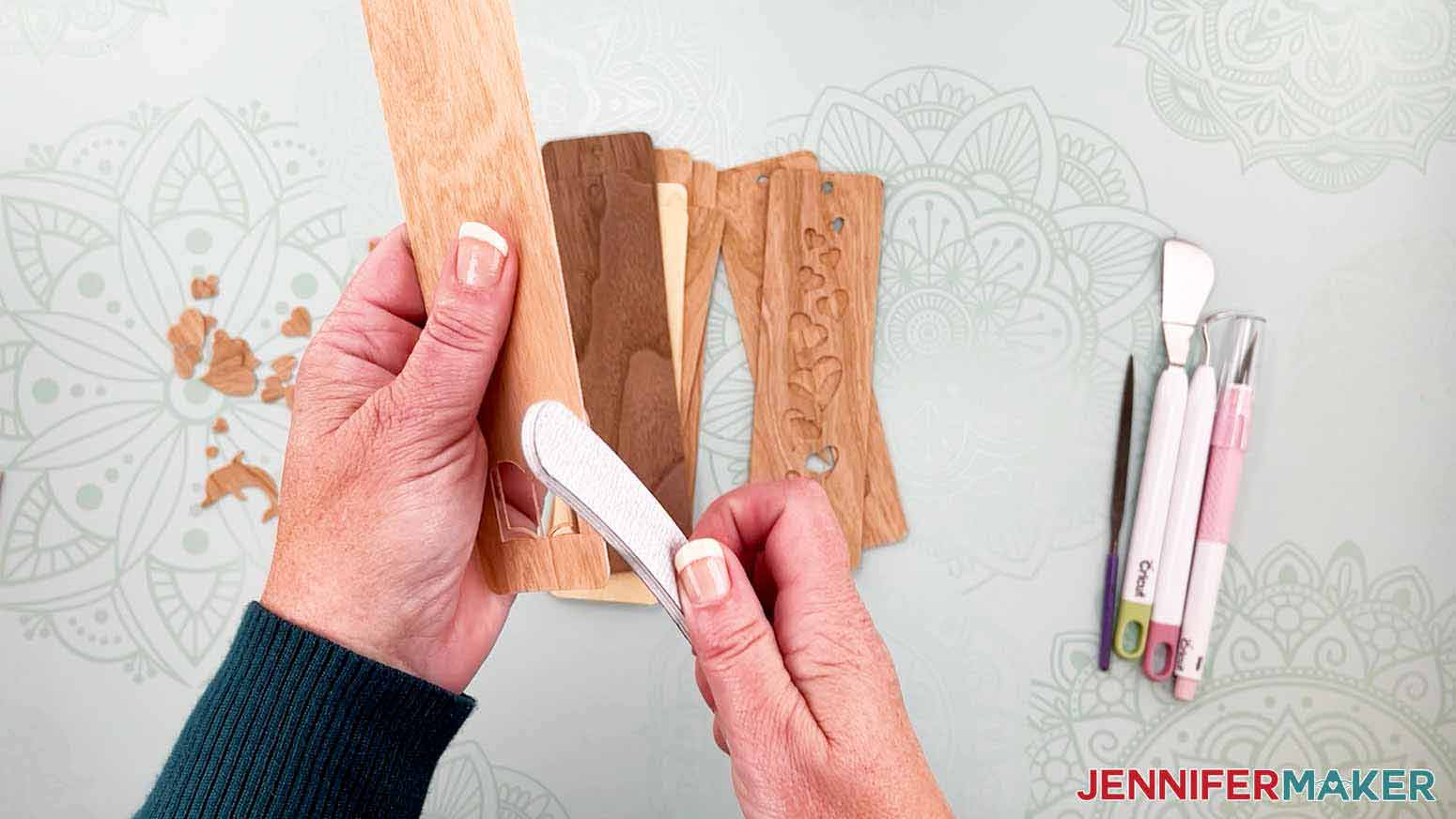 Use a nail file or sand paper to smooth the edges of the bookmark for my wooden bookmarks project