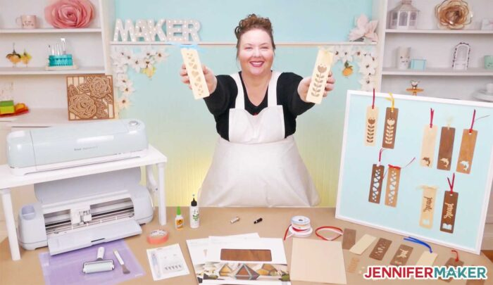 Jennifer Maker with her wooden bookmarks and Cricuts in her craft studio