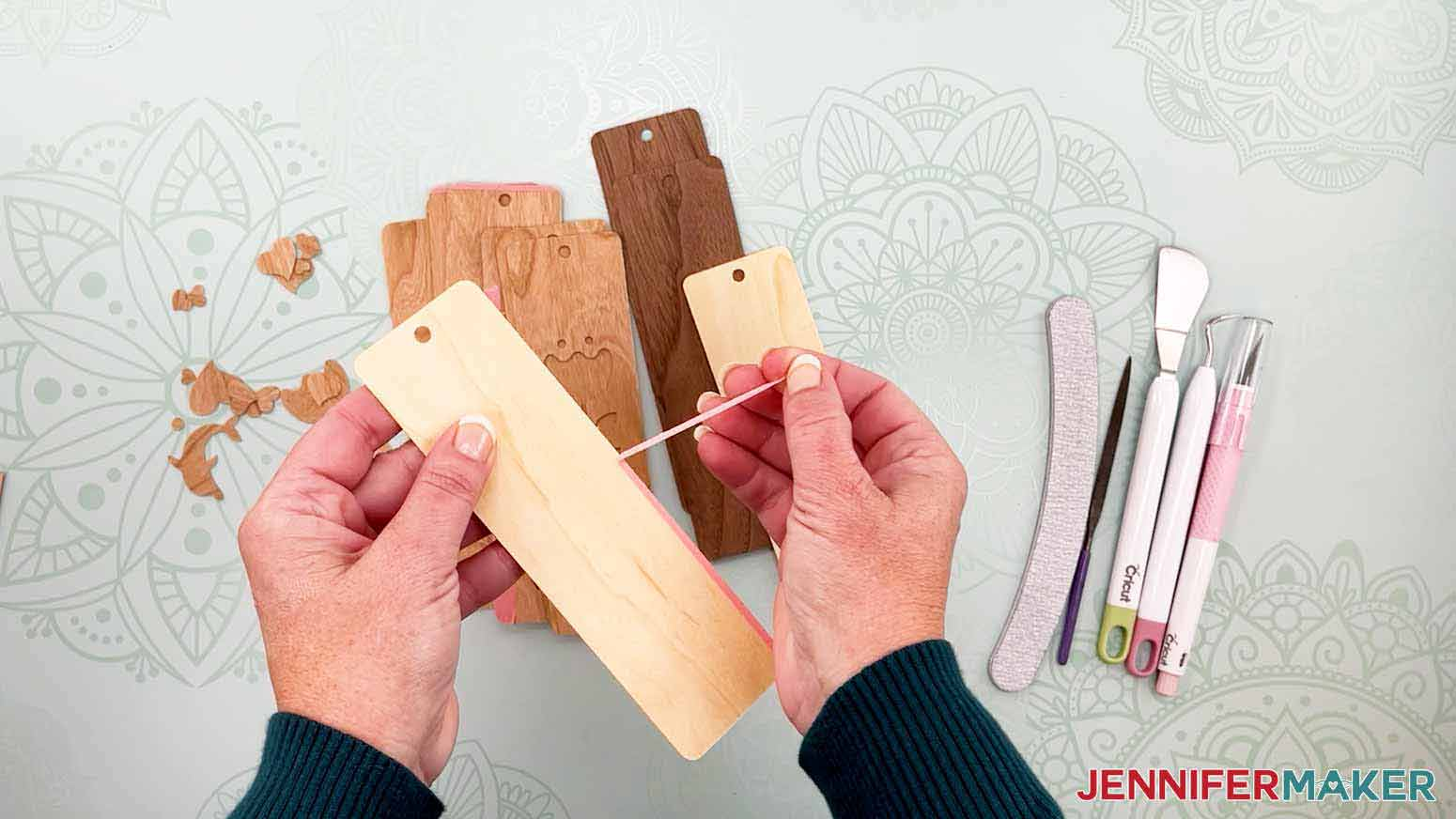 Remove excess painter's tape from the veneer for my wooden bookmarks project