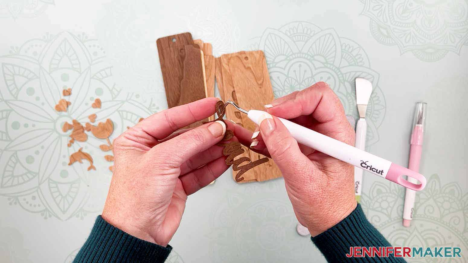 Use a weeding tool to help remove small pieces of veneer for my wooden bookmarks project